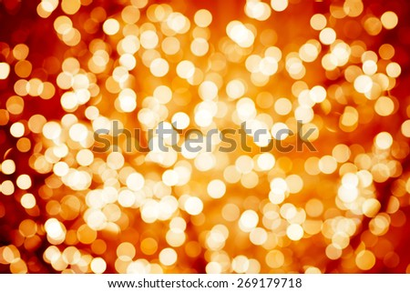 Flame-coloured background with natural bokeh defocused sparkling lights. Colorful fiery texture with twinkling lights. Bright and vivid colors - stock photo