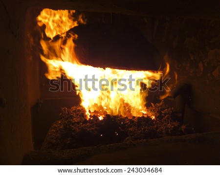 flame in a small coal-boiler