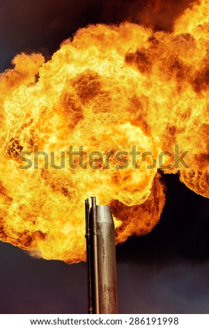 Flame of an oil torch against the night sky - stock photo