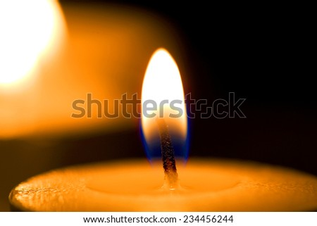 Flame of candle in darkness - stock photo