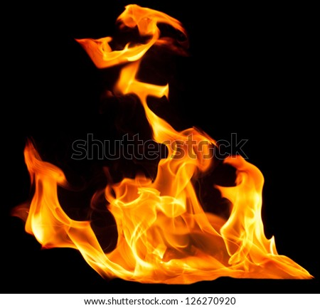 Flame of Fire with smoke on black background - stock photo