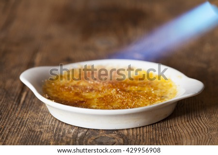flame on a creme brulee  - stock photo