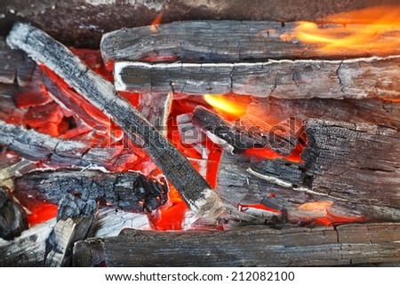 flame over burning wood-burning coals close up - stock photo
