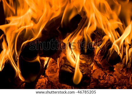 Flame tips in the fireplace - stock photo