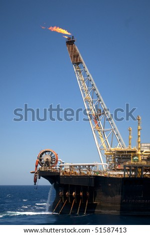 flame tower of an oil rig in offshore area in coast of brazil - stock photo
