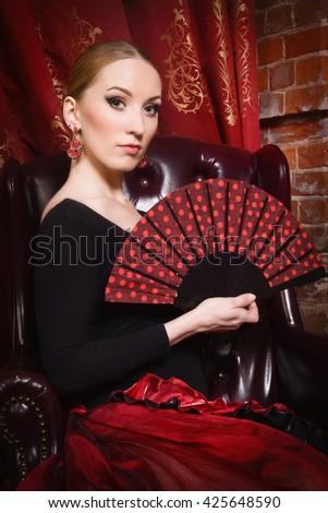 Flamenco Carmen beautiful woman in black dress with fan - stock photo