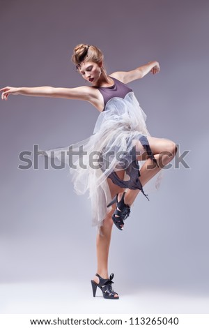 Flamenco dancer in vintage retro dress dancing isolated - renaissance style - stock photo