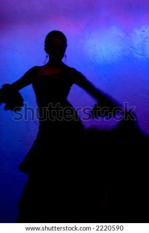 Flamenco dancer silhouette over blue background - stock photo