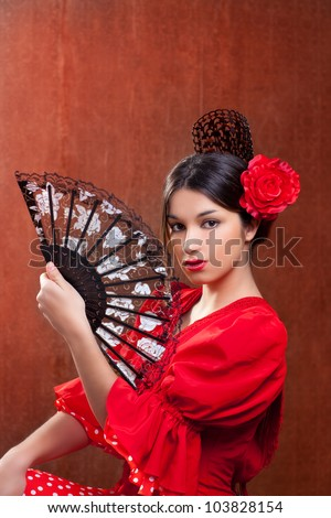 Flamenco dancer Spain woman gypsy with red rose spanish hand fan and peineta comb - stock photo