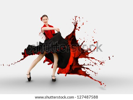 Flamenco dancer with dress turning to paint splashing on white background - stock photo