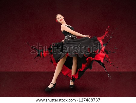 Flamenco dancer with dress turning to paint splatter on deep red background