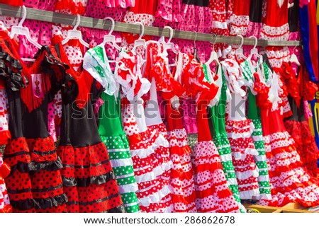 flamenco dresses in bright colors for little girls - stock photo