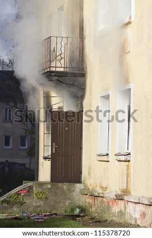 Flames and smoke of a bad house fire - stock photo