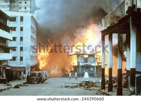 Flames engulf buildings in Panama City during urban combat between the Panamanian Defense Force and U.S. forces during the invasion of Panama. Dec. 21 1989. - stock photo