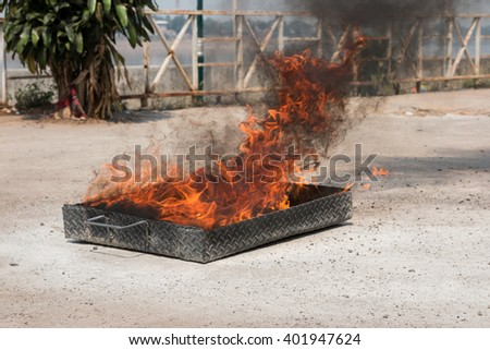 Flames in a container. - stock photo