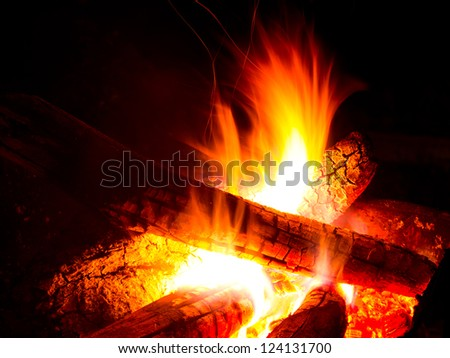 Flames in campfire at the dark night - stock photo
