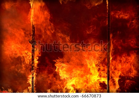 Flames of a fire rage in an inferno. - stock photo