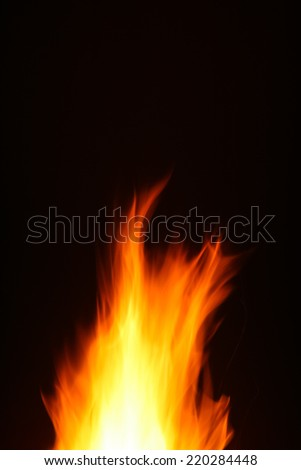 Flames of a large camp fire in the dark