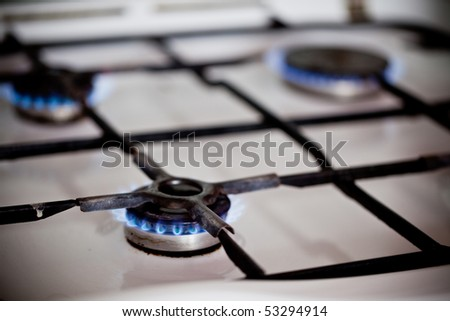 Flames of domestic kitchen gas stove. - stock photo