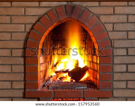 flames of fire in fireplace in evening time - stock photo