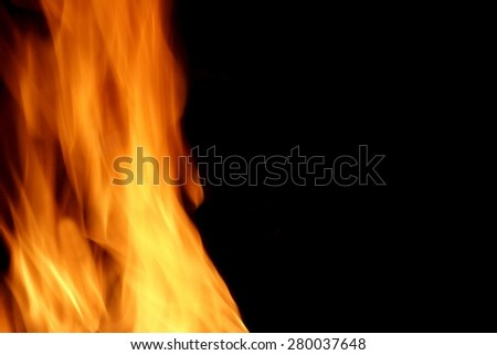Flames Of Fire On The Black Background Texture With Copy Space Close-up - stock photo