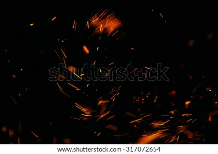 flames of fire with black background - stock photo