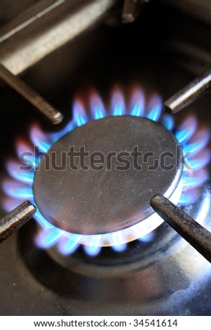Flames on the ring of a domestic gas cooker - stock photo