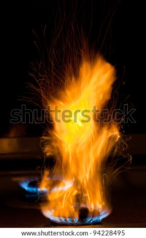 flames over gas stove - stock photo