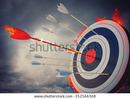 Flaming arrow hitting the center of target - stock photo
