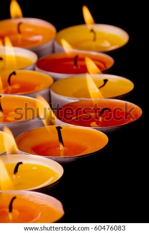 flaming candles on a dark background - stock photo