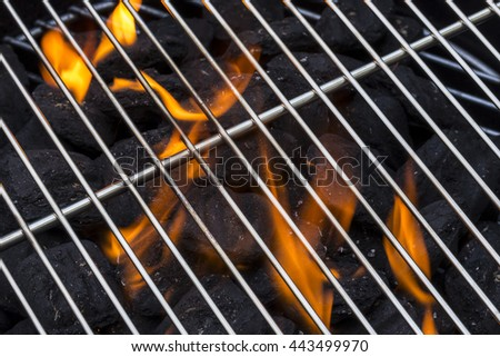 Flaming Charcoal Grill - stock photo