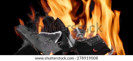 Flaming Charcoal In The Fireplace On The Black Background - stock photo