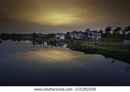 Flamingo Dai Lai, Vinh Phuc province, Vietnam - October 11, 2016 : calm lake reflection at sunset at Flamingo Dai Lai resort of Vinh Phuc Province, Vietnam