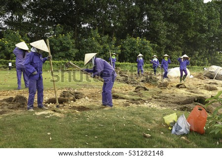 Flamingo Dai Lai, Vinh Phuc province, Vietnam - October 13, 2016 : The female workers who are working with the rudimentary tools at Flamingo Dai Lai resort of Vinh Phuc Province, Vietnam