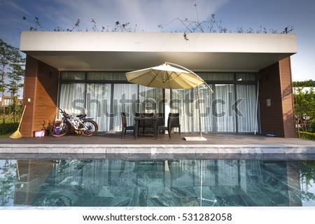 Flamingo Dai Lai, Vinh Phuc province, Vietnam - October 12, 2016 : the living room of a villa overlooking the beautiful pool at Flamingo Dai Lai resort of Vinh Phuc Province, Vietnam