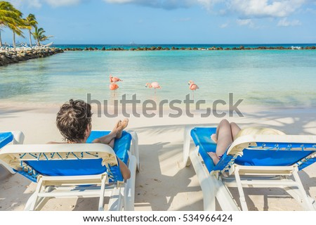 Flamingos beach in Aruba. Young couple resting