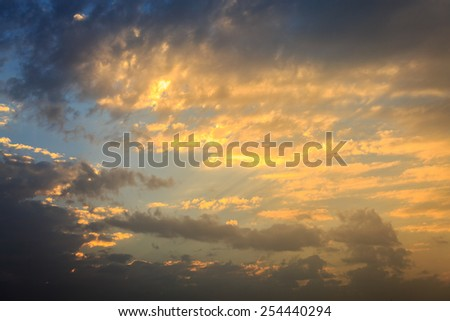 Flammable golden sunset in the sky - stock photo