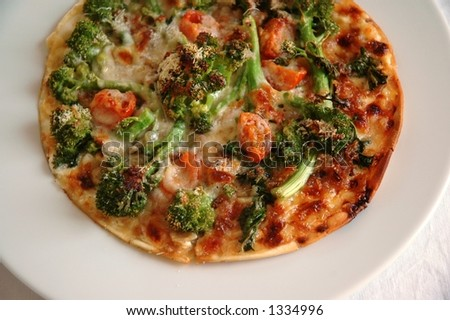 ... and bacon tart with some broccoli rabe tomatoes parmesan cheese cream
