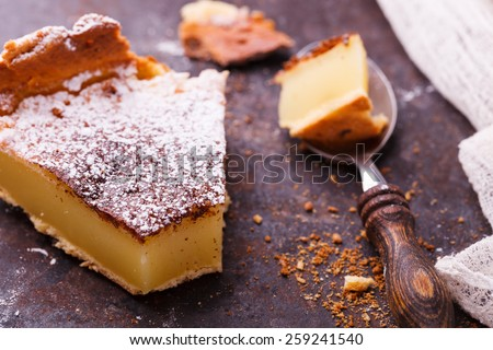Flan at home, sprinkled with powdered sugar.selective focus - stock photo
