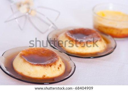 """Flan: Sweet custard with a caramel topping. Pudding. Vanilla flavour. Cr���¨me caramel, known as """"flan"""" in the US and Spanish speaking countries, and """"caramel custard"""" in UK. - stock photo"""
