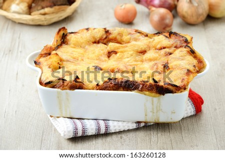 Flan with onions and cheese - stock photo