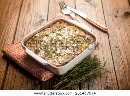 flan with potatoes and red chicory, selective focus - stock photo
