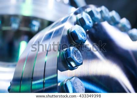 Flanged vacuum equipment. Shiny metal surface. - stock photo