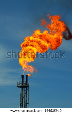 Flare burn in oil and gas society. - stock photo