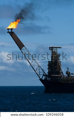 Flare of an FPSO oil rig - stock photo