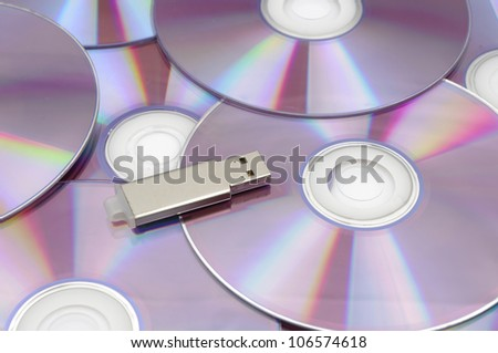 Flash-Disk and CD-ROM - stock photo