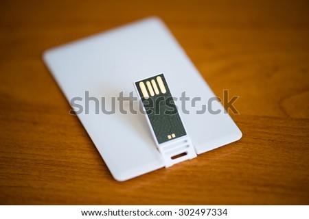 Flash drive. Credit card. - stock photo