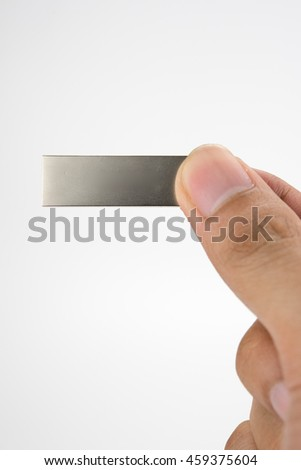 Flash drive in the hand.