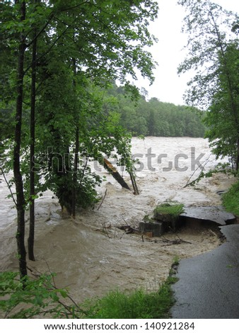 Flash Flood. Natural Disaster. Devastated Road - stock photo