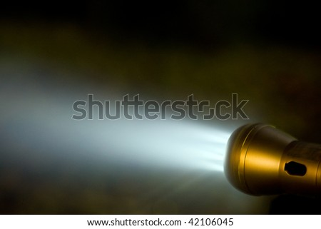 Flash light generating a beam of light - stock photo